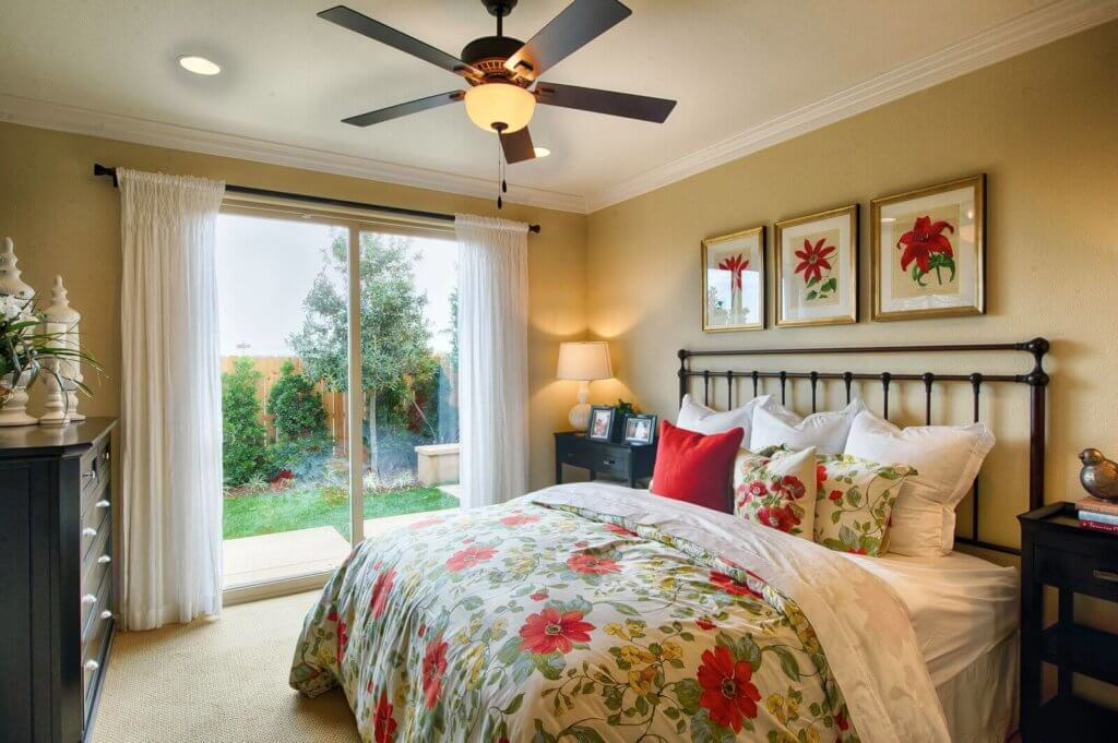 large bedroom with exterior glass doors