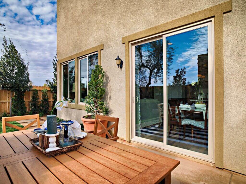 backyard view of glass door and window