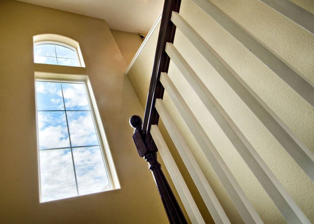 tall window next to staircase